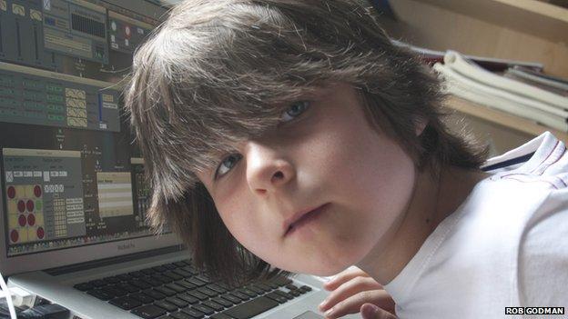 Aaron Godman, 7, at music mixing desk