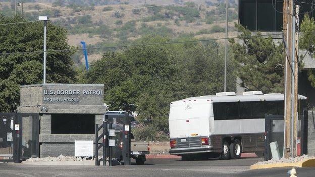 A bus enters the US Border Patrol facility in Nogales, Arizona.