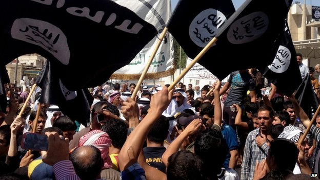 ISIS supporters demonstrate in front of the provincial government headquarters in Mosul, 360km (225 miles) north-west of Baghdad