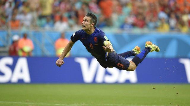 Robin Van Persie leaping to score