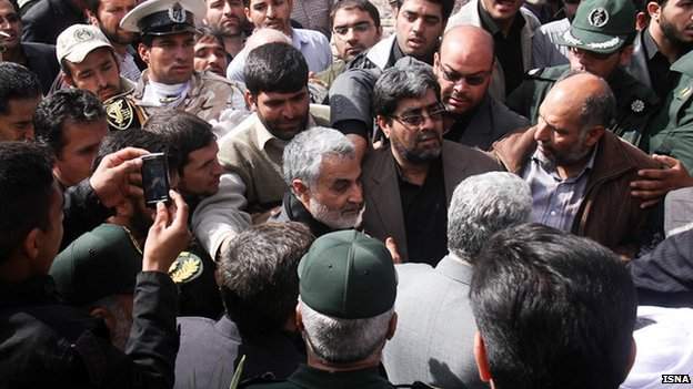 Qasem Soleimani attends the funeral of an Iranian soldier killed in Syria