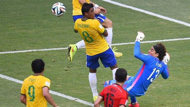 Mexico's Ochoa blocks Paulinho effort