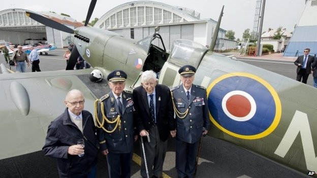 Czech war veterans, from left, navigator Petr Arton and pilots Emil Bocek, Thomas Gibian and Alois Dubec at the military airport in Prague-Kbely before the ceremonial unveiling of a bronze statue of a winged lion, 17 June 2014