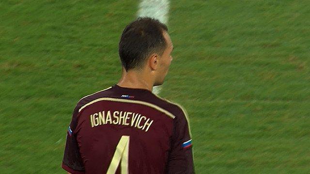 Russia's Sergei Ignashevich hits a free-kick from range