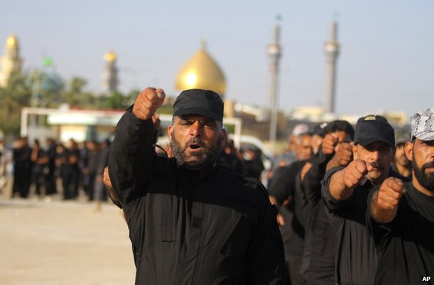 Volunteers train at military base in the Shia holy city of Najaf, 100 miles (160km) south of Baghdad, 17 June 2014
