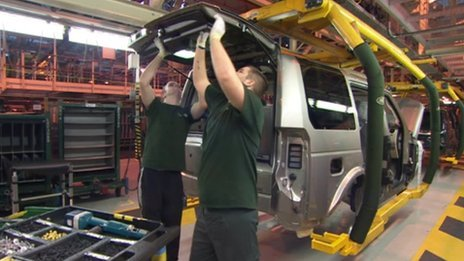 Jaguar Land Rover workers on the production line