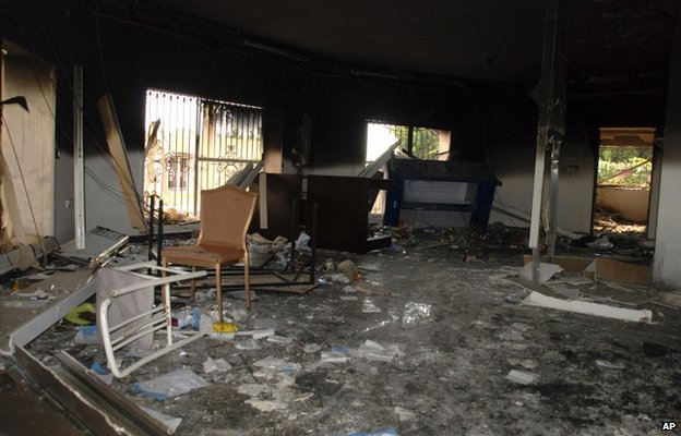 The file photo shows glass, debris and overturned furniture are strewn inside a room in the gutted US consulate in Benghazi, Libya, after an attack that killed four Americans, including Ambassador Chris Stevens