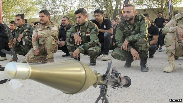 Fighters loyal to a Shia cleric take part in a military training in Baghdad. 19 June 2014