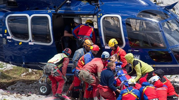 Johann Westhauser is carried to the helicopter outside the Riesending cave complex. 19 June 2014
