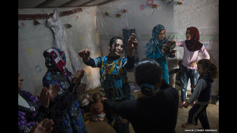 Female Syrian refugees dance around at a wedding celebration in a refugee camp in Marj El-Khokh, in Marjaayoun, Lebanon, March 6, 2014.