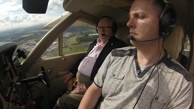 Mike Warren, left, and pilot Colin Granton