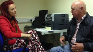 Citizens Advice worker helping patient at GP surgery
