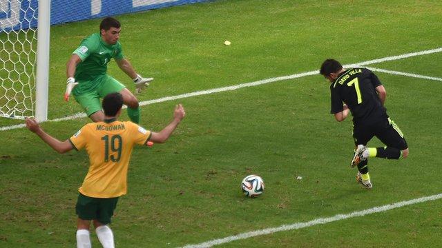 Spain's David Villa scores with skilful backheel