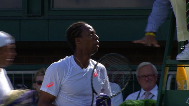 Gael Monfils and the umpire engage in discussion after a bizarre game