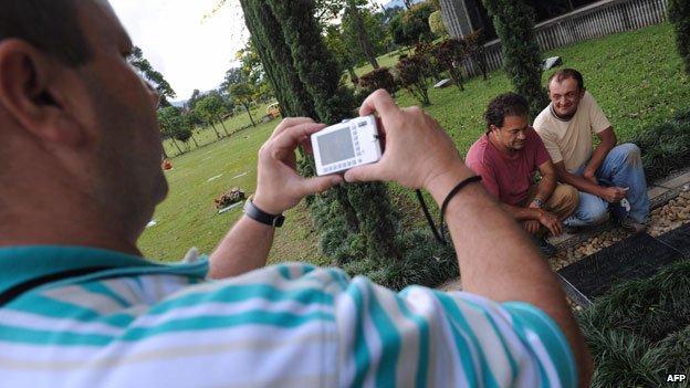 Tourists at Pablo Escobar's grave