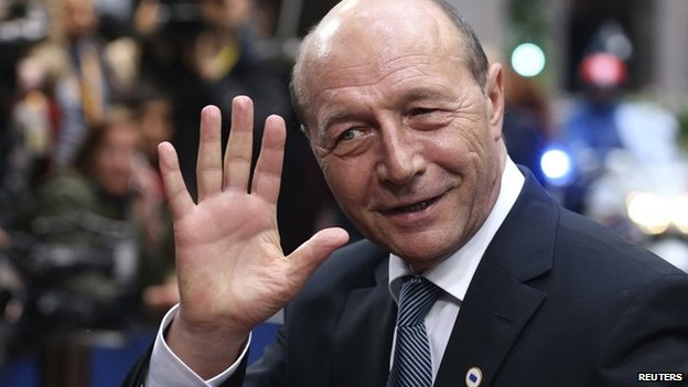 Romania's President Traian Basescu waves as he arrives at an informal summit of European Union leaders in Brussels - 27 May 2014
