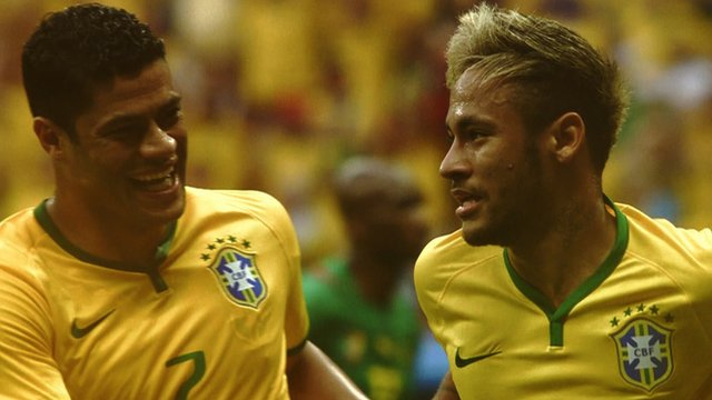 Brazil's Neymar celebrates with Hulk after scoring in the 2014 World Cup