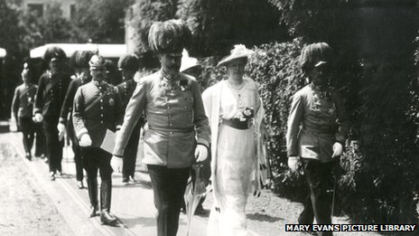 Archduke Franz Ferdinand and his wife walking along with others in Sarajevo before their assassination.