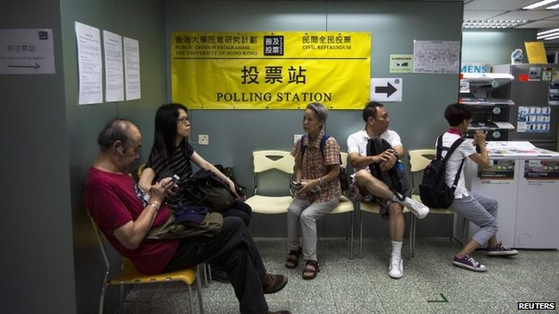 People wait to vote at a polling station in Hong Kong. Photo: 29 June 2014