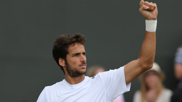 Feliciano Lopez celebrates win against John Isner at Wimbledon