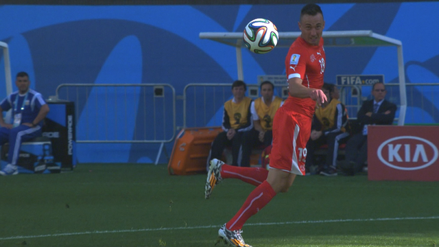 Switzerland's Drmic fluffs a one-on-one chance when through on goal in the first half against Argentina