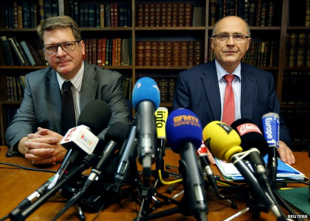 Marseille's state prosecutor Brice Robin (R) and inter-regional head of judicial police Christian Sainte (L) attend a news conference in Marseille - 24 June 2014