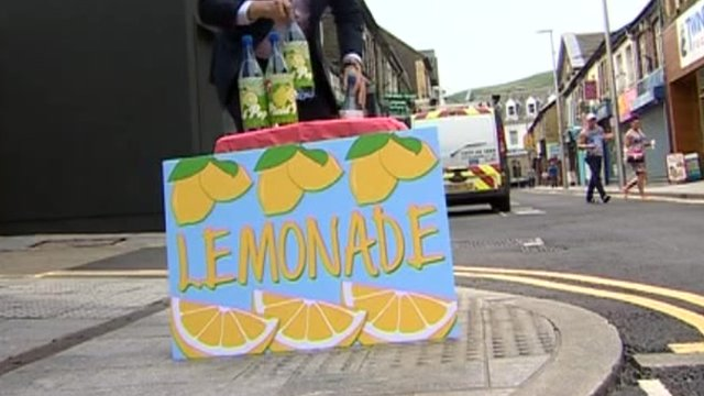 Mock-up of a lemonade stall on a street in Porth