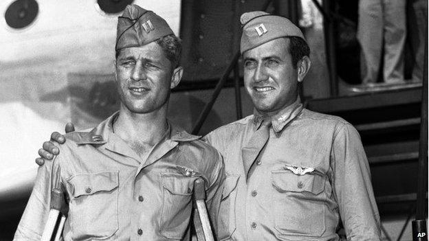 Capt. Louis Zamperini, right, of Torrance, Calif., and Capt. Fred Garrett of Riverside, Calif., arrive at Hamilton Air Field, later Hamilton Air Force Base, in Novato, California 3 October 1945