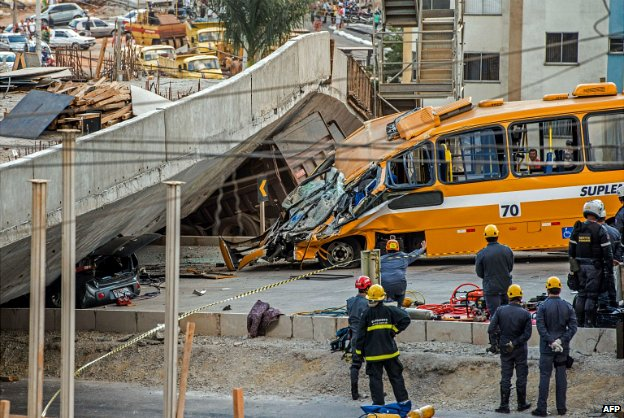 Firefighters inspect the bus that was crushed by a flyover that collapsed in Belo Horizonte - 3 July 2014