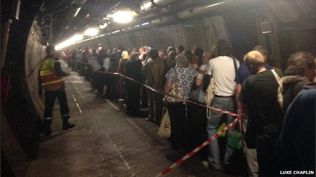 Passengers queuing in the tunnel