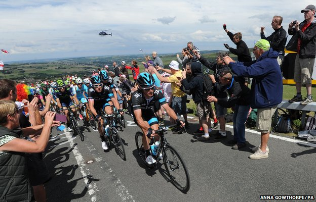 Team Sky is cheered along as stage two of the Tour de France passes over Holme Moss Moor, Yorkshire