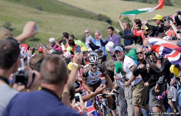 Spectators line the road as France's Blel Kadri climbs in the breakaway group