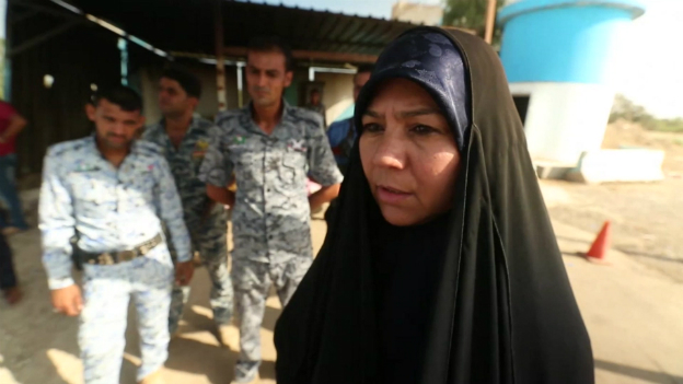 An Iraqi woman talks to the BBC team north of Baghdad - 6 July 2014