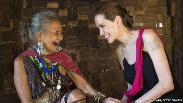 Angelina Jolie talking to an older lady