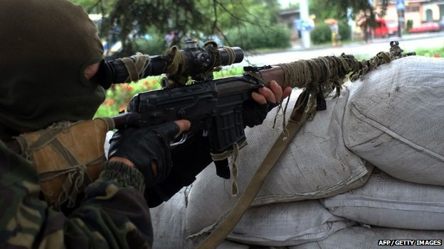 A pro-Russian militant manning a checkpoint in Donetsk on 8 July 2014.