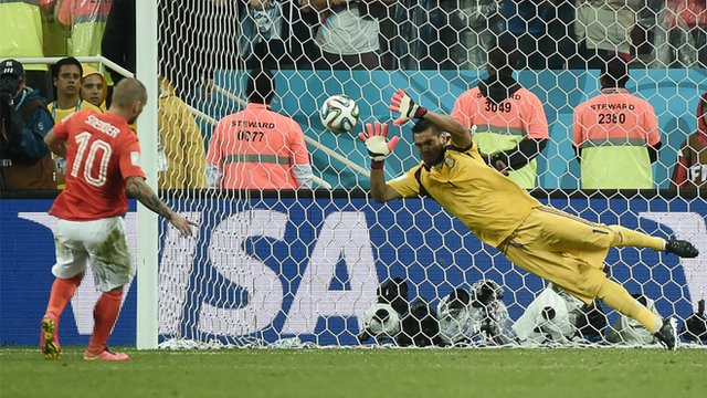 Netherlands' Wesley Sneijder has his penalty saved by Argentina's Sergio Romero