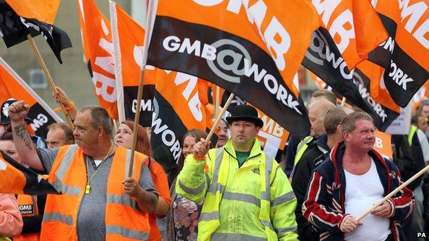 Members of the GMB union make their way through Brighton