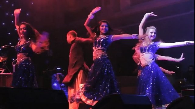 Bollywood dancers on stage performing
