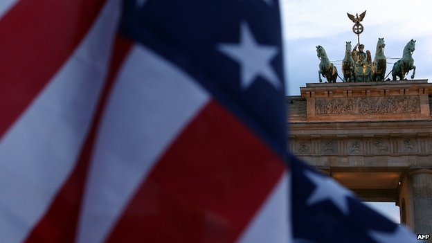 US flag with Berlin's Brandenburg Gate in background. 8 July 2014