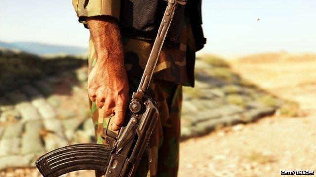Kurdish soldiers with the Peshmerga keep guard near the frontline with Sunni militants on the outskirts of Kirkuk, an oil-rich Iraqi city on June 25, 2014 in Kirkuk, Iraq