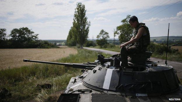 Ukrainian soldier atop tank near Konstantinovka