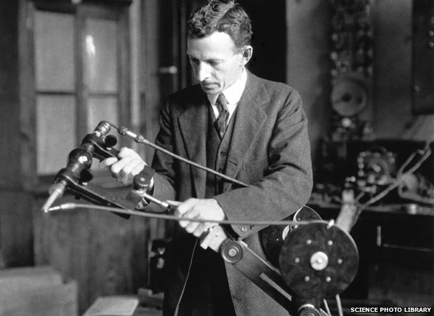 William David Coolidge holds an early portable X-ray tube