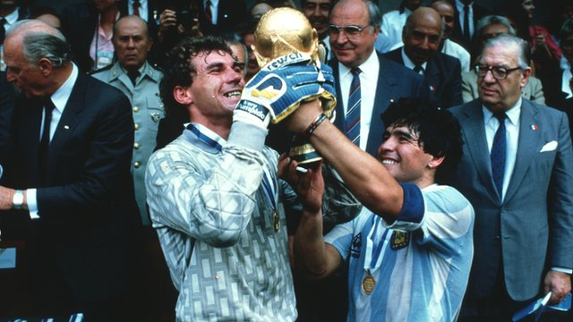 Nery Pompido and Diego Maradona hold aloft the World Cup