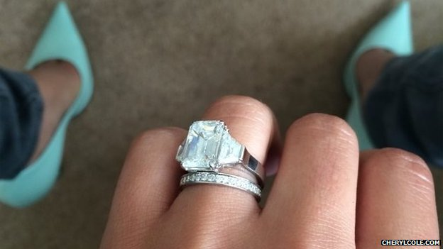 A picture posted on Cheryl Cole's website showing a hand wearing engagement and wedding rings