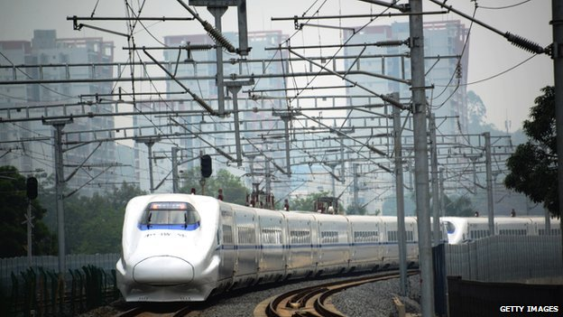 A high-speed train travels on the railway to Beijing in Nanning, southern China's Guangxi province on 13 June, 2014