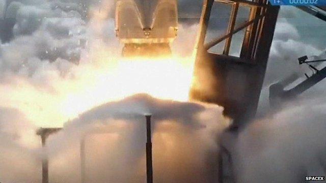 Base of rocket blasting off launch pad