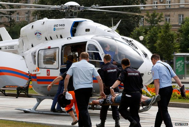 Injured person being taken to helicopter after Moscow metro crash (15 July)
