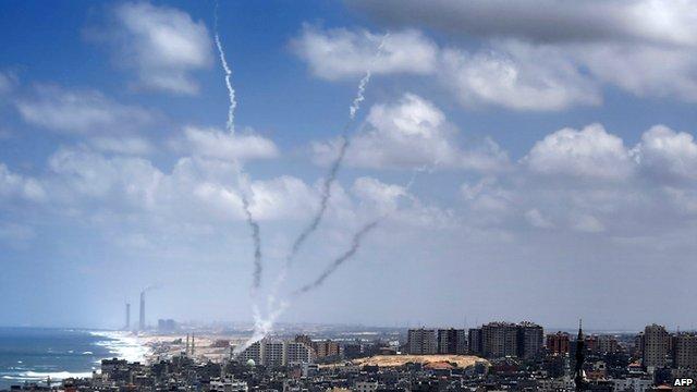 Smoke from rockets fired from near Gaza City