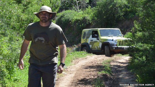 """Scott """"LB"""" Williams with jeep in the background"""