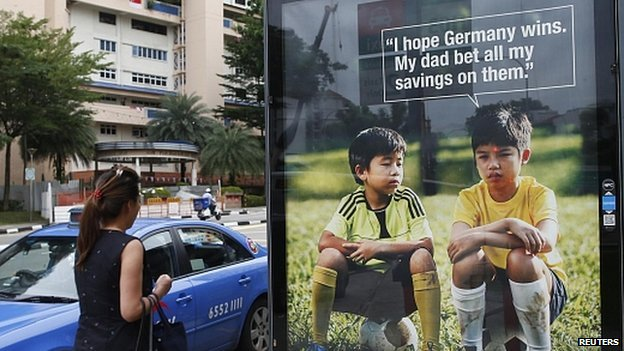 World Cup anti-gambling advertisement at taxi stand in Singapore. 9 July 2014